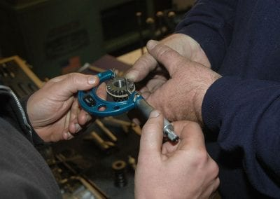 Measuring gear lash for pinion and cam gears. Too tight a mesh and they whine. Too loose and they make a ticking sound.