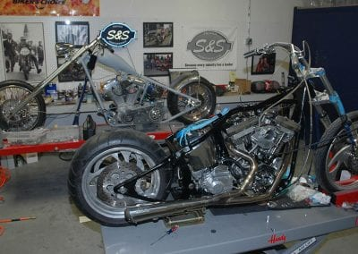 Working on both bikes. One chopper with rigid frame, and one custom bike with softail frame.